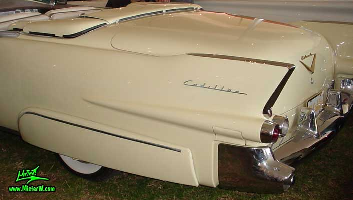 Photo of a white 1955 Cadillac Eldorado Convertible at a classic car auction in Scottsdale, Arizona.