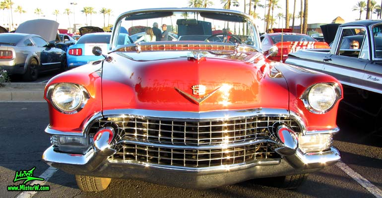 Photo of a red 1955 Cadillac Eldorado Convertible at the Scottsdale Pavilions Classic Car Show in Arizona. Frontview of a 1955 Cadillac Eldorado Convertible