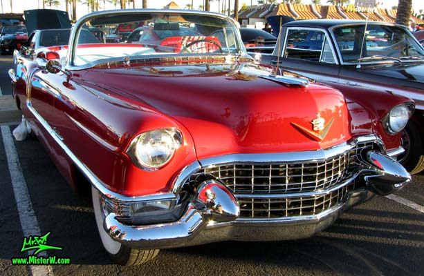 Photo of a red 1955 Cadillac Eldorado Convertible at the Scottsdale Pavilions Classic Car Show in Arizona. 55 Eldorado
