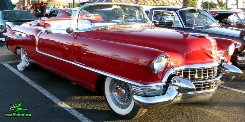 Photo of a red 1955 Cadillac Eldorado Convertible at the Scottsdale Pavilions Classic Car Show in Arizona. 55 Cadillac Eldorado Convertible