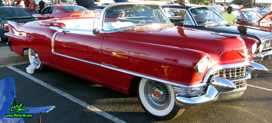 Photo of a red 1955 Cadillac Eldorado Convertible at the Scottsdale Pavilions Classic Car Show in Arizona. Sideview of a 1955 Cadillac Eldorado Convertible