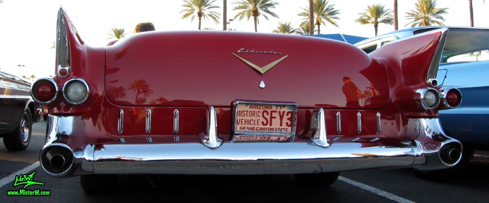 Photo of a red 1955 Cadillac Eldorado Convertible at the Scottsdale Pavilions Classic Car Show in Arizona. Rearview of a 1955 Cadillac Eldorado Convertible