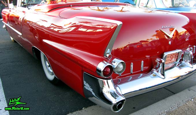 Photo of a red 1955 Cadillac Eldorado Convertible at the Scottsdale Pavilions Classic Car Show in Arizona. Tail Fin of a 1955 Cadillac Eldorado Convertible