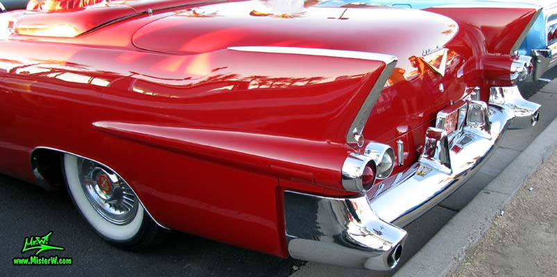 Photo of a red 1955 Cadillac Eldorado Convertible at the Scottsdale Pavilions Classic Car Show in Arizona. Tail Lights & Fins of a 55 Cadillac Eldorado