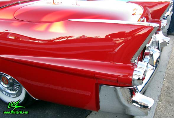 Photo of a red 1955 Cadillac Eldorado Convertible at the Scottsdale Pavilions Classic Car Show in Arizona. 1955 Cadillac Eldorado Tailfins
