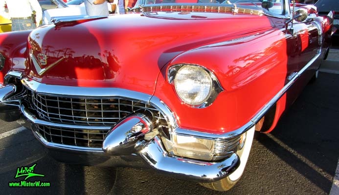 Photo of a red 1955 Cadillac Eldorado Convertible at the Scottsdale Pavilions Classic Car Show in Arizona. 55 Cadillac Eldorado Front Chrome Grill