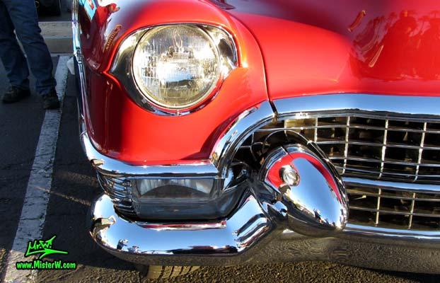Photo of a red 1955 Cadillac Eldorado Convertible at the Scottsdale Pavilions Classic Car Show in Arizona. 1955 Cadillac Eldorado Head Light