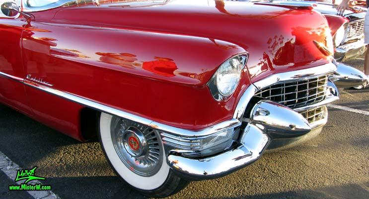Photo of a red 1955 Cadillac Eldorado Convertible at the Scottsdale Pavilions Classic Car Show in Arizona. Massive Front Bumper of a 55 Cadillac Eldorado