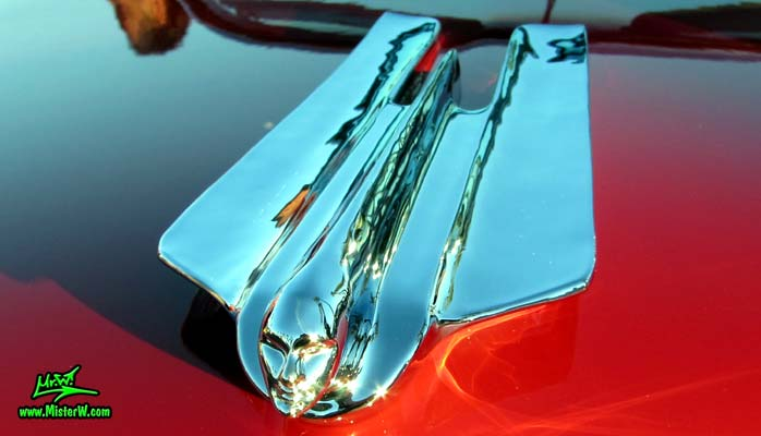 Photo of a red 1955 Cadillac Eldorado Convertible at the Scottsdale Pavilions Classic Car Show in Arizona. Hood Ornament of a 1955 Cadillac Eldorado Convertible