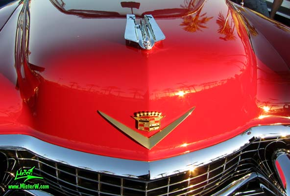Photo of a red 1955 Cadillac Eldorado Convertible at the Scottsdale Pavilions Classic Car Show in Arizona. Chrome Emblem of a 55 Cadillac Eldorado Convertible