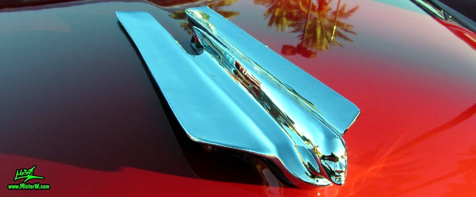 Photo of a red 1955 Cadillac Eldorado Convertible at the Scottsdale Pavilions Classic Car Show in Arizona. 55 Cadillac Eldorado Hood Ornament