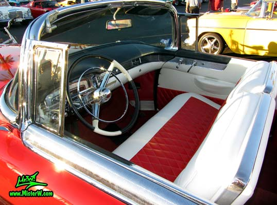 Photo of a red 1955 Cadillac Eldorado Convertible at the Scottsdale Pavilions Classic Car Show in Arizona. Dash & Interior of a 55 Cadillac Eldorado Convertible