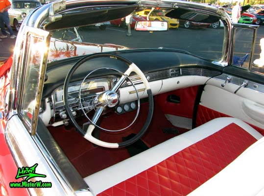Photo of a red 1955 Cadillac Eldorado Convertible at the Scottsdale Pavilions Classic Car Show in Arizona. 55 Cadillac Eldorado Speedometer & Dashboard