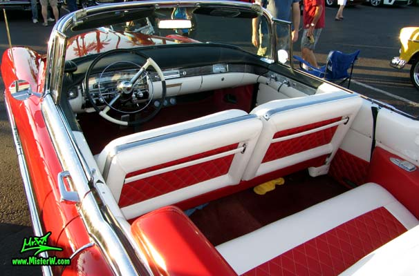 Photo of a red 1955 Cadillac Eldorado Convertible at the Scottsdale Pavilions Classic Car Show in Arizona. 55 Cadillac Eldorado Convertible Dashboard & Interior