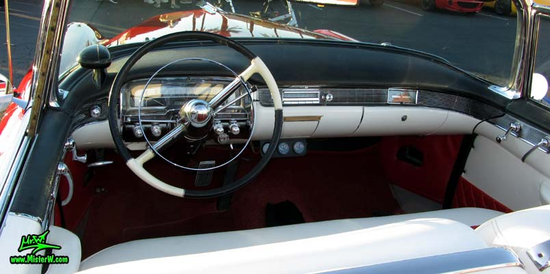 Photo of a red 1955 Cadillac Eldorado Convertible at the Scottsdale Pavilions Classic Car Show in Arizona. Dash Board of a 1955 Cadillac Eldorado Convertible