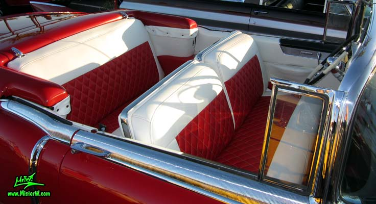 Photo of a red 1955 Cadillac Eldorado Convertible at the Scottsdale Pavilions Classic Car Show in Arizona. 1955 Cadillac Eldorado Convertible Interior & Rear Seats