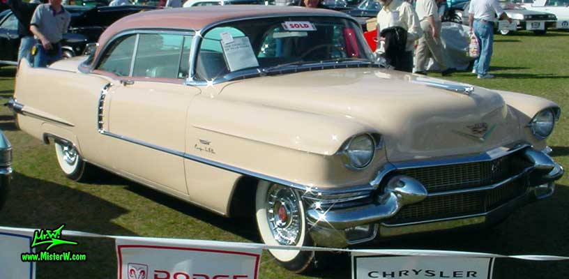 Photo of a pink 1956 Cadillac Coupe 2 Door Hardtop at a Classic Car auction in Scottsdale, Arizona. 1956 Cadillac Hardtop Coupe