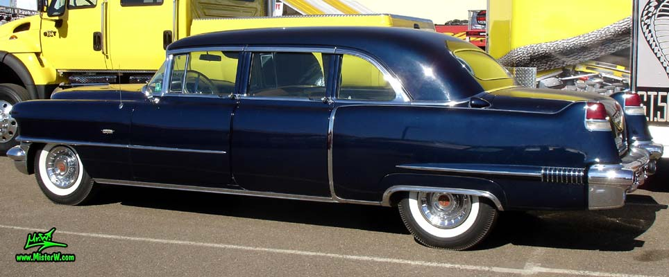 Photo of a dark blue 1956 Cadillac Fleetwood Series 75 Limousine at a Classic Car auction in Scottsdale, Arizona. Rearview of 56 Cadillac Fleetwood Series Seventy-Five Limo