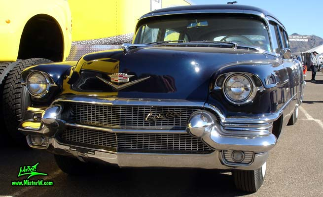 Photo of a dark blue 1956 Cadillac Fleetwood Series 75 Limousine at a Classic Car auction in Scottsdale, Arizona. Frontview of 56 Cadillac Fleetwood Series Seventy-Five Limo