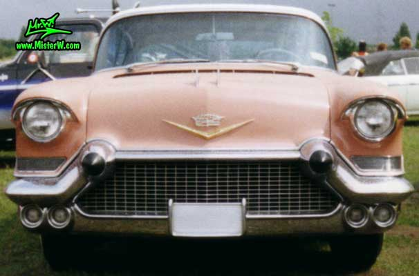 Photo of a pink 1957 Cadillac Coupe 2 Door Hardtop at a classic car meeting in K�ln Chorweiler (Cologne), Germany. 1957 Cadillac Coupe