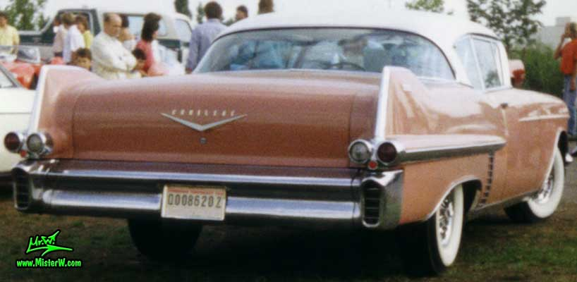 Photo of a pink 1957 Cadillac Coupe 2 Door Hardtop at a classic car meeting in K�ln Chorweiler (Cologne), Germany. Tail Fins of a pink 1957 Cadillac Coupe