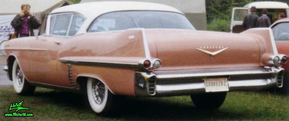 Photo of a pink 1957 Cadillac Coupe 2 Door Hardtop at a classic car meeting in Köln Chorweiler (Cologne), Germany. 1957 Cadillac 2 Door