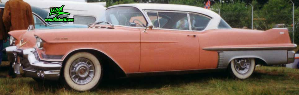 Photo of a pink 1957 Cadillac Coupe 2 Door Hardtop at a classic car meeting in Germany. Pink & white 1957 Cadillac Coupe