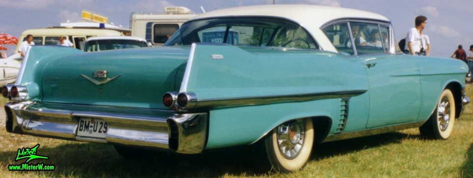 Photo of a turquoise 1957 Cadillac Coupe 2 Door Hardtop at a classic car meeting in Germany. Turquoise 1957 Cadillac Coupe