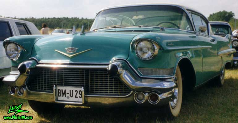 Photo of a turquoise 1957 Cadillac Coupe 2 Door Hardtop at a classic car meeting in Germany. Turquoise 1957 Caddy