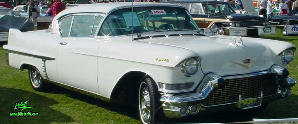 Photo of a white 1957 Cadillac Coupe 2 Door Hardtop at a classic car auction in Scottsdale, Arizona. White 1957 Cadillac Coupe at a classic car auction in Arizona