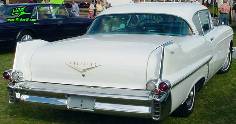Photo of a white 1957 Cadillac Coupe 2 Door Hardtop at a classic car auction in Scottsdale, Arizona. Tail Fins of a white 1957 Cadillac Coupe DeVille