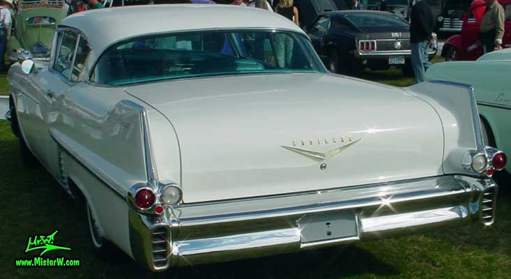 Photo of a white 1957 Cadillac Coupe 2 Door Hardtop at a classic car auction in Scottsdale, Arizona. 1957 Cadillac Coupe DeVille Fins