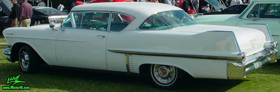Photo of a white 1957 Cadillac Coupe 2 Door Hardtop at a classic car auction in Scottsdale, Arizona. 1957 Cadillac Coupe 4 Sale
