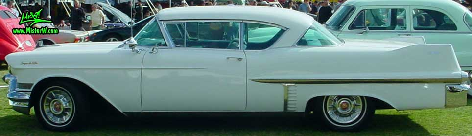 Photo of a white 1957 Cadillac Coupe 2 Door Hardtop at a classic car auction in Scottsdale, Arizona. Sideview of a white 1957 Cadillac Coupe DeVille