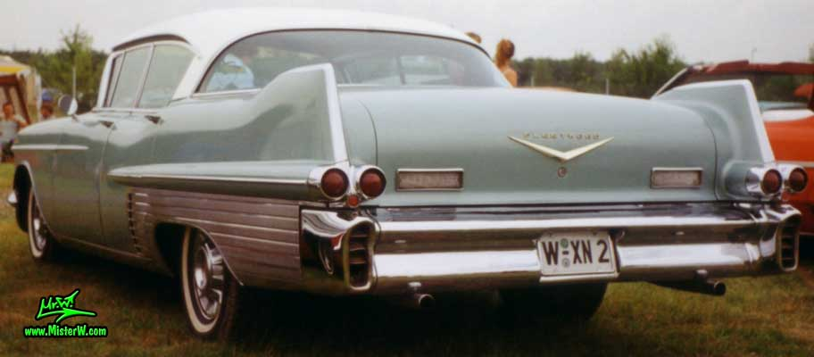 Photo of a turquoise 1957 Cadillac Fleetwood Series Sixty Special 4 Door Hardtop Sedan at a classic car meeting in Germany. Tail Fins of a 1957 Cadillac Fleetwood 60 Special