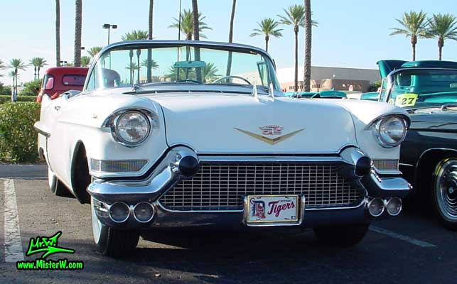 Photo of a white 1957 Cadillac Series 62 Convertible at the Scottsdale Pavilions Classic Car Show in Arizona. 57 Caddy Convertible