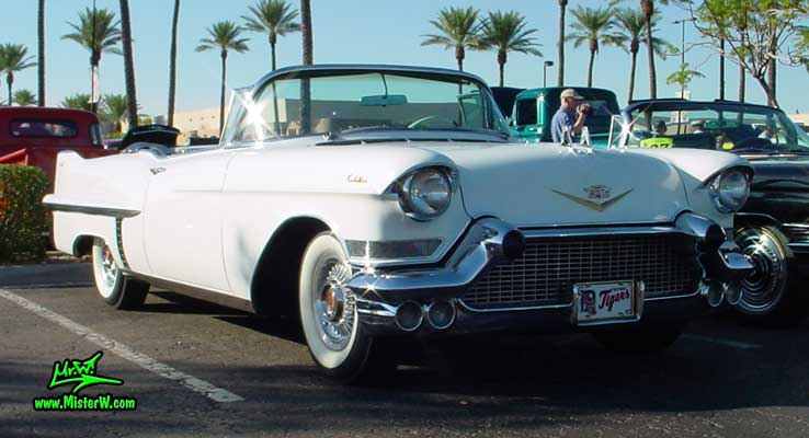 Photo of a white 1957 Cadillac Series 62 Convertible at the Scottsdale Pavilions Classic Car Show in Arizona. 1957 Cadillac Convertible at the Scottsdale Pavillions Classic Car Show in Arizona