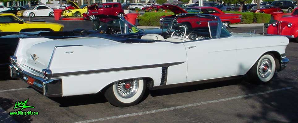 Photo of a white 1957 Cadillac Series 62 Convertible at the Scottsdale Pavilions Classic Car Show in Arizona. Classic 1957 Cadillac Convertible