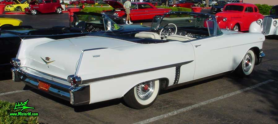 Photo of a white 1957 Cadillac Series 62 Convertible at the Scottsdale Pavilions Classic Car Show in Arizona. Topless 1957 Cadillac