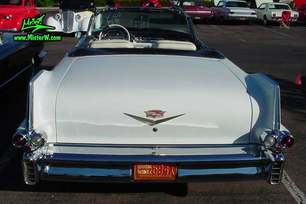 Photo of a white 1957 Cadillac Series 62 Convertible at the Scottsdale Pavilions Classic Car Show in Arizona. 1957 Cadillac Tail Fins
