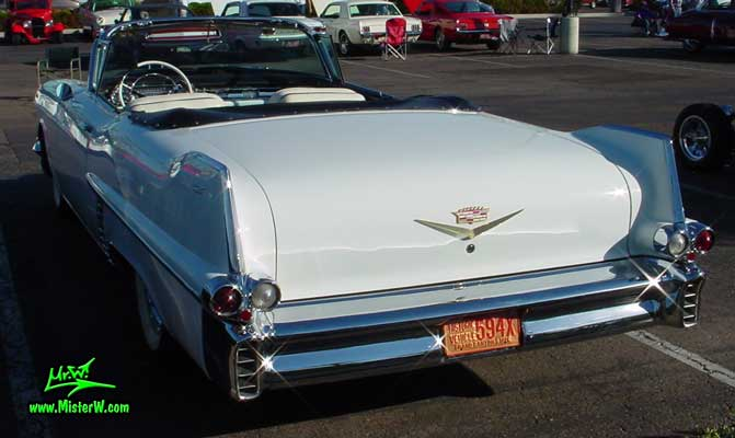Photo of a white 1957 Cadillac Series 62 Convertible at the Scottsdale Pavilions Classic Car Show in Arizona.