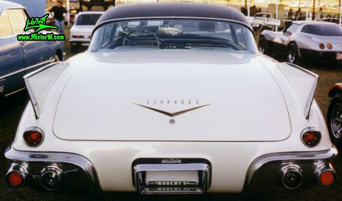 Photo of a white 1957 Cadillac Eldorado SeVille 2 Door Hardtop Coupe at a classic car auction in Scottsdale, Arizona. Rearview of a 1957 Cadillac Eldorado SeVille