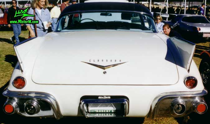 Photo of a white 1957 Cadillac Eldorado SeVille 2 Door Hardtop Coupe at a classic car auction in Scottsdale, Arizona. The beautifull back of a 1957 Cadillac Eldorado SeVille