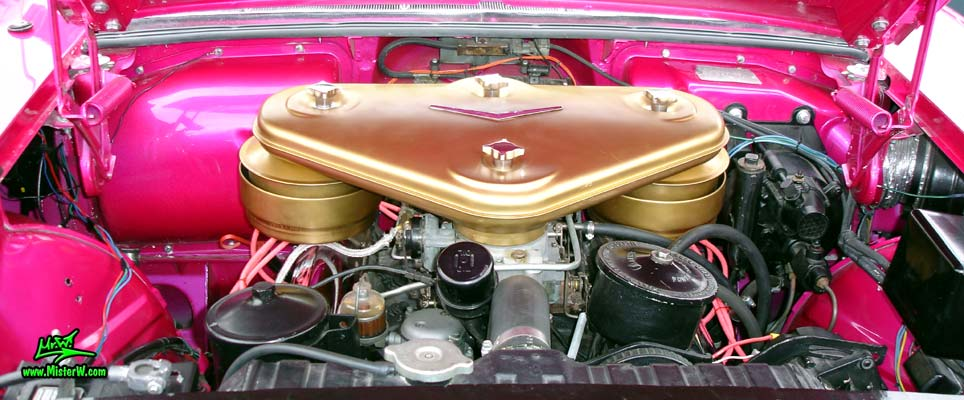 Photo of a purple violet 1957 Cadillac Eldorado Biarritz Convertible at the Scottsdale Pavilions Classic Car Show in Arizona. Golden air cleaner of a 1957 Cadillac Eldorado Biarritz Convertible