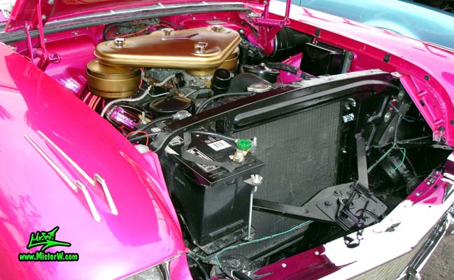 Photo of a purple violet 1957 Cadillac Eldorado Biarritz Convertible at the Scottsdale Pavilions Classic Car Show in Arizona. Motor compartment of a 1957 Cadillac Eldorado Biarritz Convertible