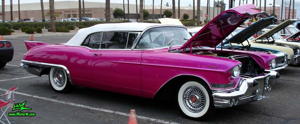 Photo of a purple violet 1957 Cadillac Eldorado Biarritz Convertible at the Scottsdale Pavilions Classic Car Show in Arizona. Frontview of a 1957 Cadillac Eldorado Biarritz Convertible