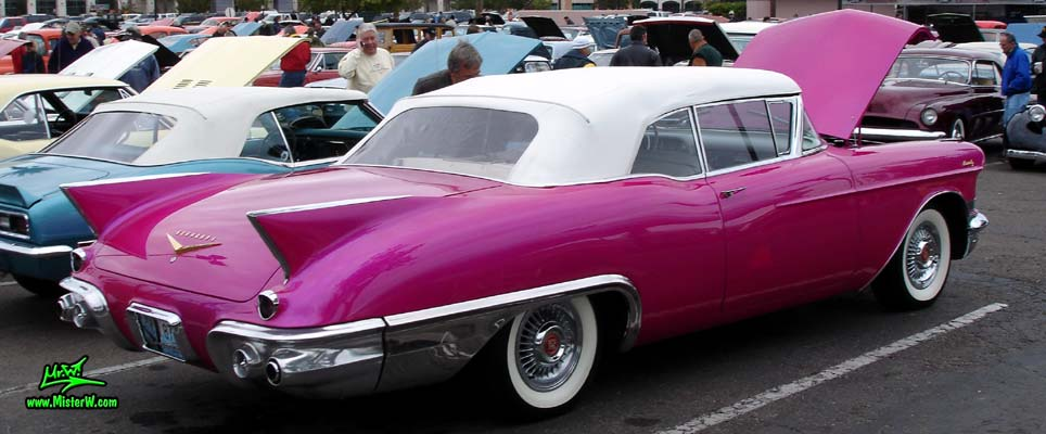 Photo of a purple violet 1957 Cadillac Eldorado Biarritz Convertible at the Scottsdale Pavilions Classic Car Show in Arizona. Sideview of a 1957 Cadillac Eldorado Biarritz Convertible