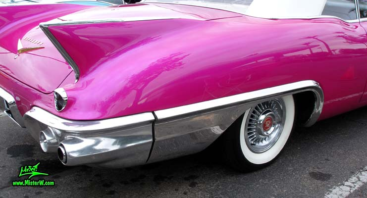 Photo of a purple violet 1957 Cadillac Eldorado Biarritz Convertible at the Scottsdale Pavilions Classic Car Show in Arizona. Tailfin of a 1957 Cadillac Eldorado Biarritz Convertible