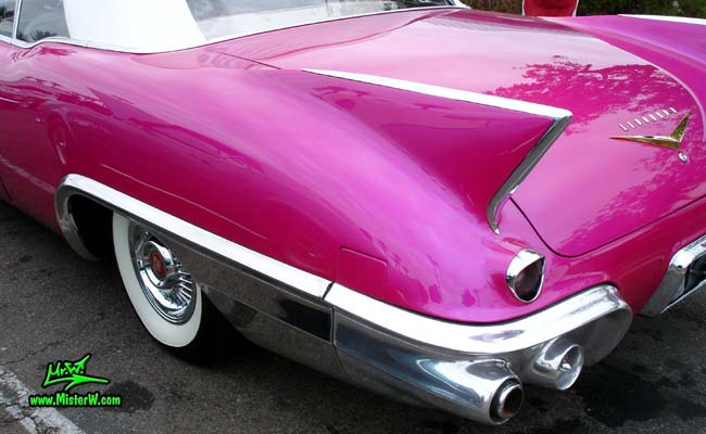 Photo of a purple violet 1957 Cadillac Eldorado Biarritz Convertible at the Scottsdale Pavilions Classic Car Show in Arizona. Shark fin of a 1957 Cadillac Eldorado Biarritz Convertible