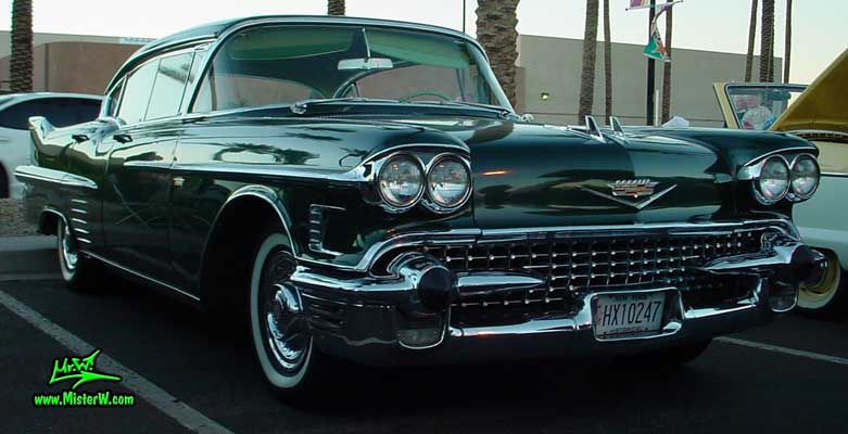 Photo of a black 1958 Cadillac 4 Door Hardtop Sedan at the Scottsdale Pavilions Classic Car Show in Arizona. 1958 Caddy